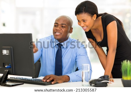 handsome african businessman and secretary working in the office - stock photo
