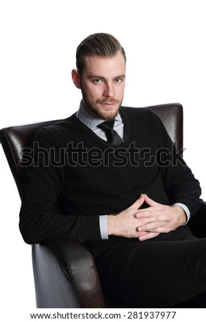 Handsome and laid back businessman sitting down in an arm chair, feeling satisfied. White background. - stock photo