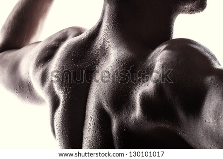 Handsome athlete on a white background - stock photo