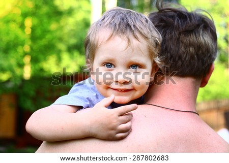 handsome baby boy with his dad close up portrait  - stock photo