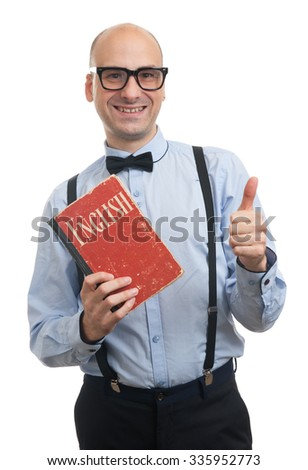 handsome bald man wearing bow tie and suspenders learning English - stock photo