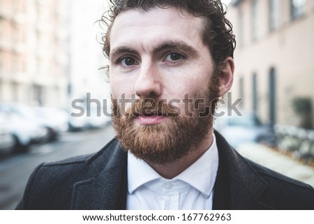 handsome bearded hipster elegant man in the city - stock photo