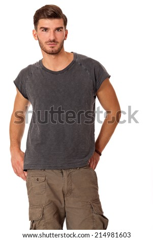 Handsome bearded young man with a lovely charismatic smile wearing a cotton t-shirt, isolated on white - stock photo
