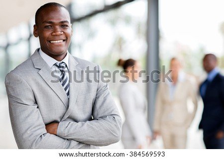 handsome black businessman executive looking at the camera - stock photo