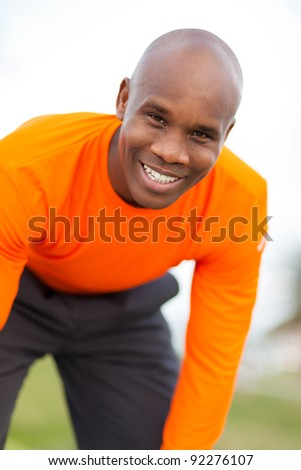 Handsome black man exercising outdoors in a Miami Beach park. - stock photo