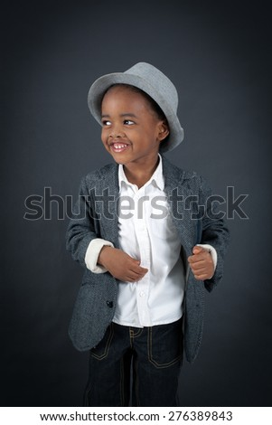 Handsome boy doing different expressions in different sets of clothes: hungry - stock photo