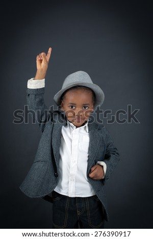 Handsome boy doing different expressions in different sets of clothes: want to speak - stock photo