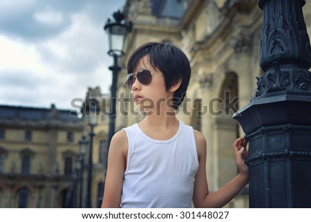 Handsome boy posing in Paris - stock photo