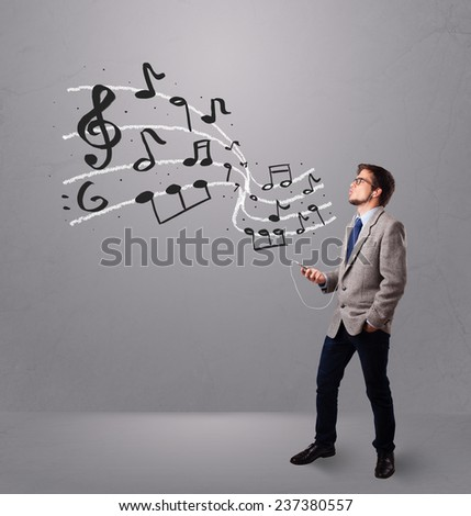 handsome boy singing and listening to music with musical notes getting out og his mouth - stock photo