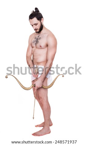 Handsome brawny young man drawing a bow. Antiquity, Valentine, Cupid. Studio portrait isolated over white background    - stock photo