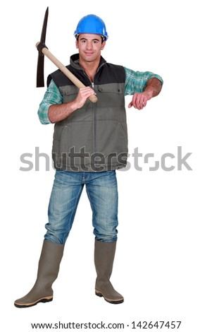 Handsome bricklayer - stock photo