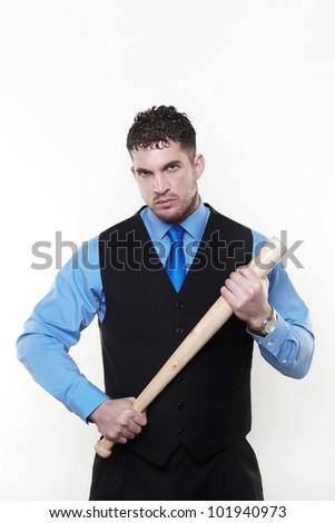 Handsome business man holding a baseball bat looking a bit hard - stock photo