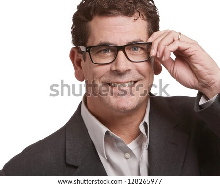 Handsome business man holding glasses isolated on white - stock photo