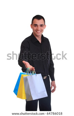 Handsome business man holding shopping bags - isolated over a white background - stock photo