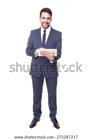 Handsome business man standing with tablet computer, isolated on white background - stock photo