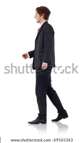 Handsome business man walking, over white background - stock photo