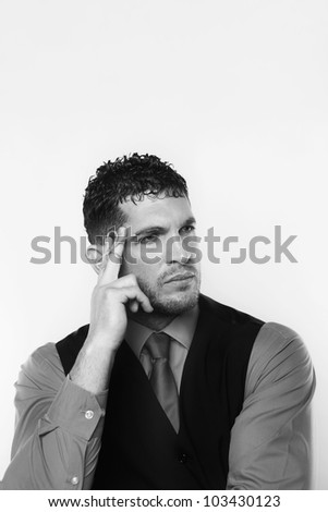 handsome business man with a piece of string tied round his finger so hes not going to forget something - stock photo