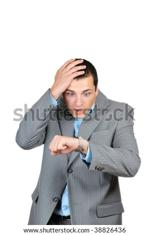 Handsome businessman checking his wrist-watch isolated on white background - stock photo