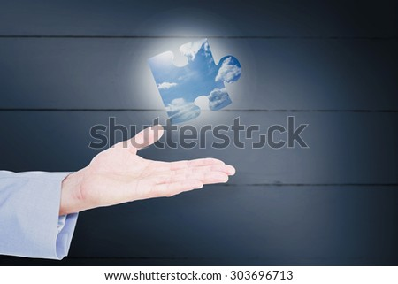 Handsome businessman gesturing with hands against blue sky Handsome businessman gesturing with hands on a white background - stock photo