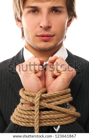 Handsome businessman hands tied with rope together - stock photo