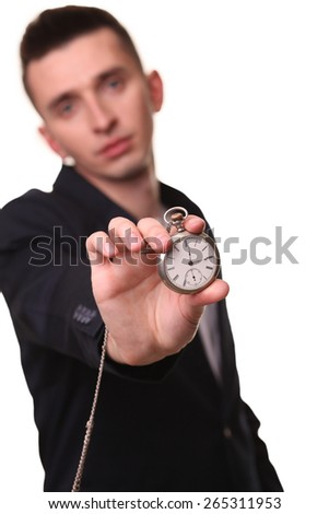 Handsome businessman holding a clock. Over white background - stock photo
