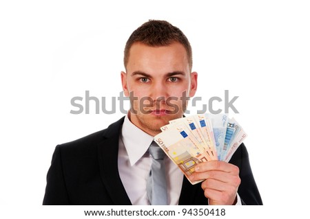 handsome businessman holding money isolated on a white background - stock photo
