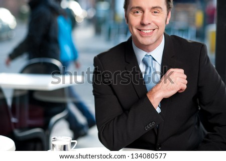 Handsome businessman in open-air cafe. - stock photo