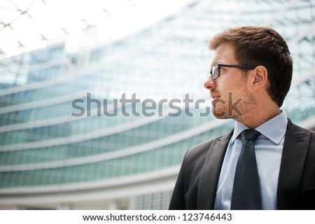 Handsome businessman in the city - stock photo