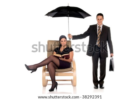 Handsome businessman,  insurance agent, attractive woman sitting in sofa.  Studio, white background. - stock photo