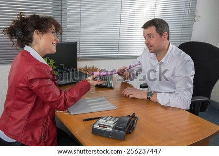 Handsome businessman interviewing female - stock photo