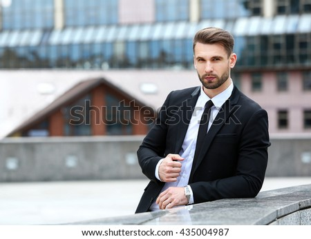 Handsome businessman is waiting for his client - stock photo