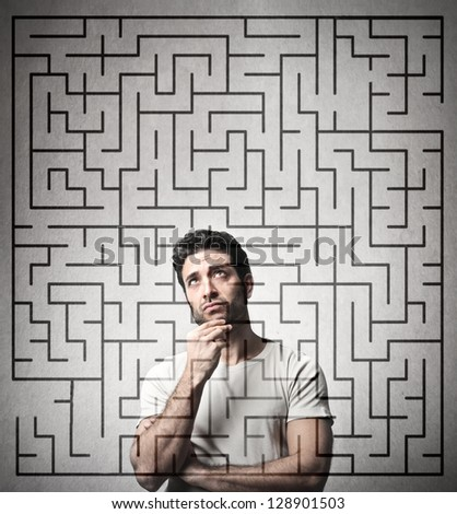 handsome businessman looking for the solution - stock photo