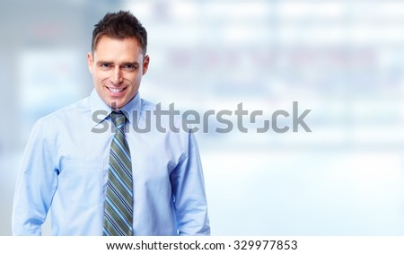 Handsome businessman over blue office banner background. - stock photo