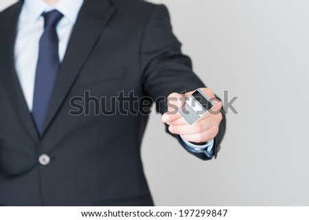 handsome businessman pays with a credit card - stock photo