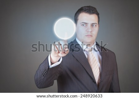 Handsome businessman pressing high tech (modern) button touch interface (virtual) - with place for logo, text or product - stock photo