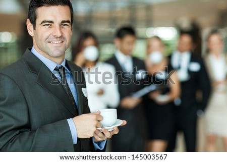 handsome businessman relaxing after a business seminar - stock photo