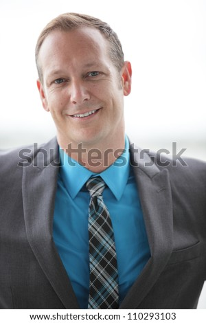 Handsome businessman smiling - stock photo
