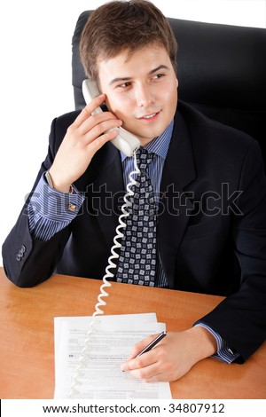 Handsome businessman speaking on the phone in an office environment - stock photo