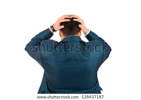 Handsome businessman standing back holding head with his hands - stock photo