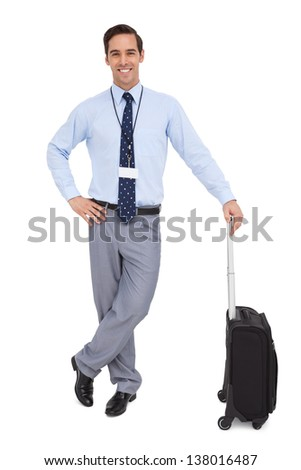 Handsome businessman standing with his suitcase on white background - stock photo