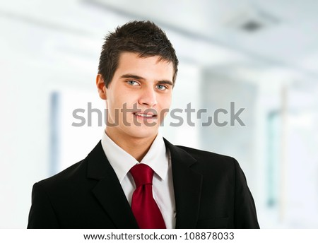 Handsome businessman with beautiful blue eyes - stock photo