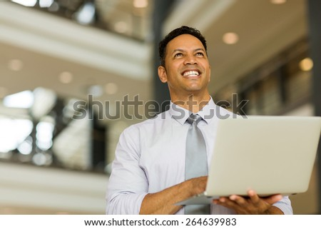 handsome businessman with laptop computer - stock photo