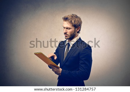 handsome businessman with tablet - stock photo