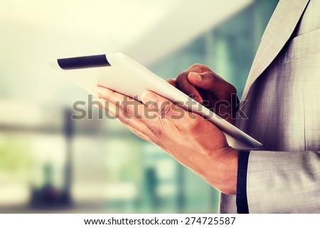 Handsome businessman with tablet computer - stock photo