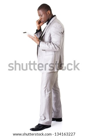 Handsome businessman with tablet , isolated on white - stock photo