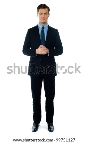 Handsome businessperson posing in front of camera - stock photo