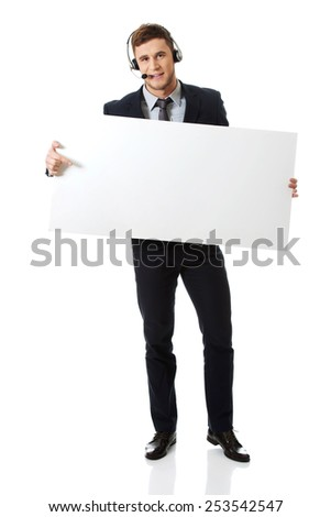 Handsome call center woman holding empty banner. - stock photo