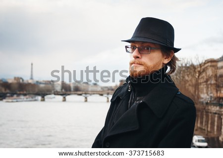Handsome Calm Bearded Man Wearing Hat in Paris, France, Looking in Camera. Headshot Composition. - stock photo