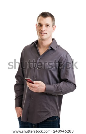 Handsome casual businessman holding a smart phone isolated on a white background - stock photo