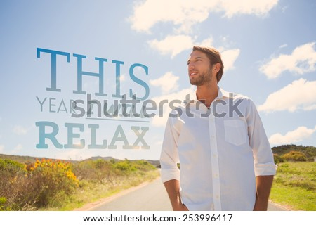 Handsome casual man standing on a road against this year i will relax - stock photo